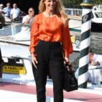 Michelle Hunziker in an Orange Blouse Arrives at 76th Venice Film Festival in Venice