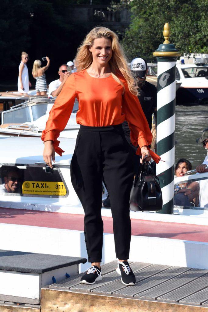 Michelle Hunziker in an Orange Blouse