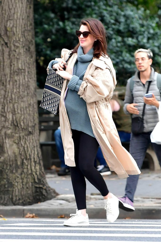 Anne Hathaway in a Beige Trench Coat