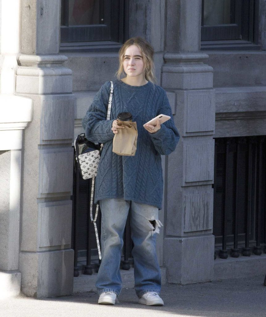 Sabrina Carpenter in a Gray Baggy Clothes