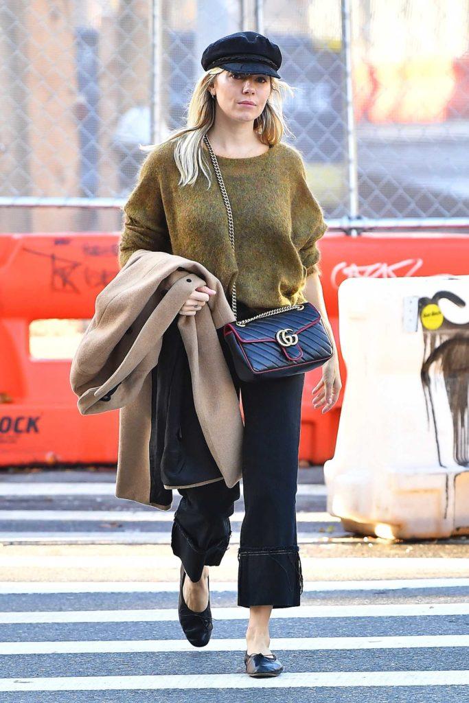 Sienna Miller in a Black Cap