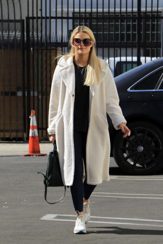 Witney Carson in a White Coat