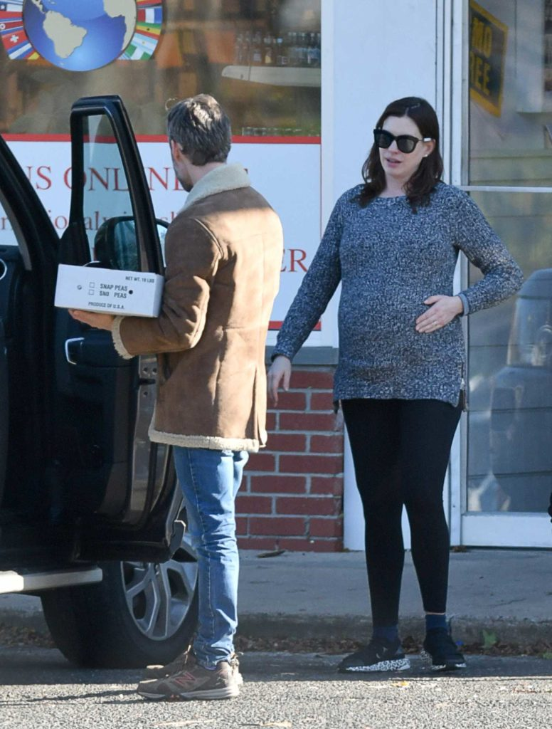 Anne Hathaway in a Gray Sweater