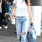Camila Morrone in a White Tee Arrives at LAX Airport in LA