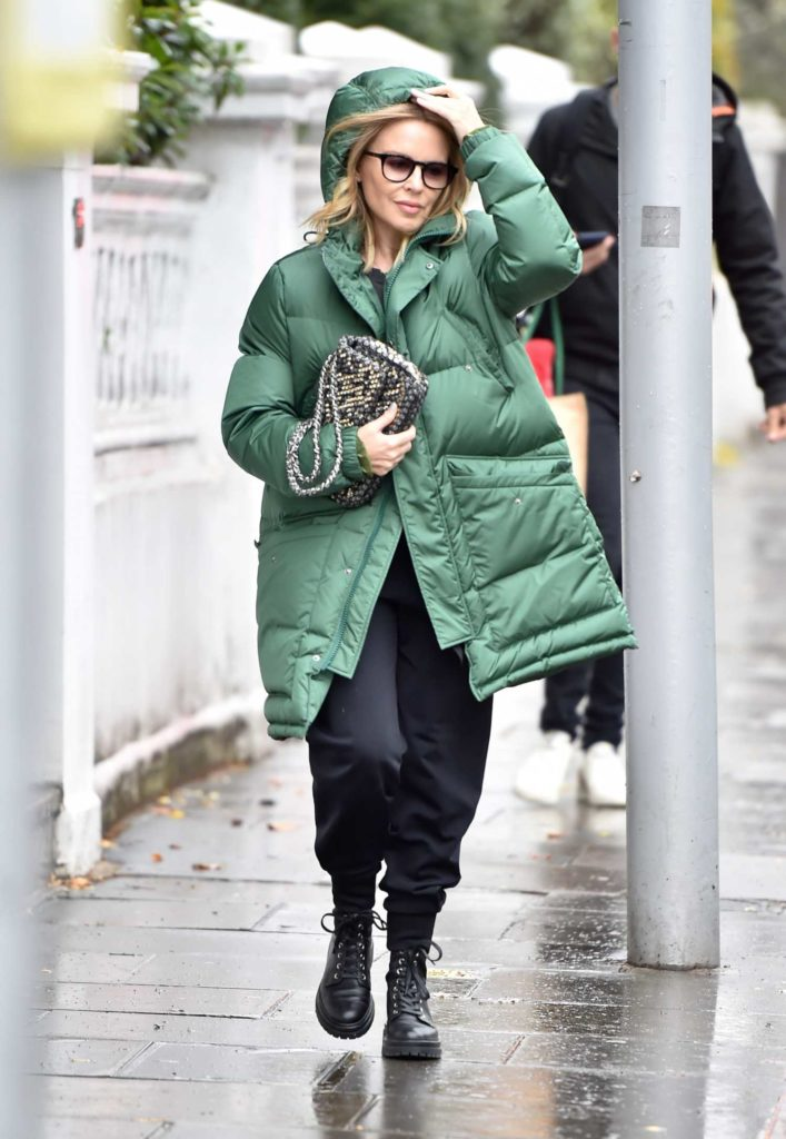 Kylie Minogue in a Green Puffer Coat