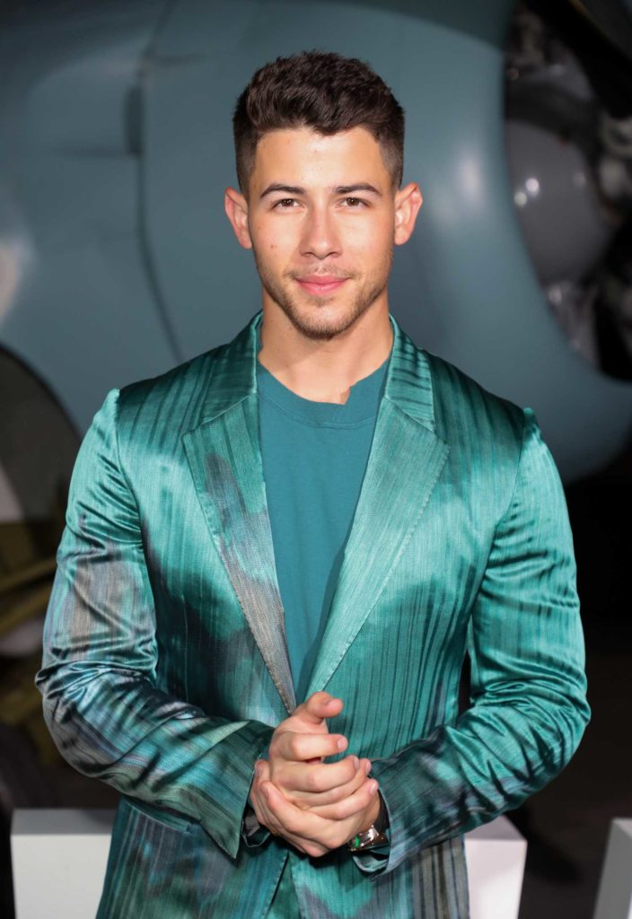 Nick Jonas Attends the Midway Premiere at Regency Village ...