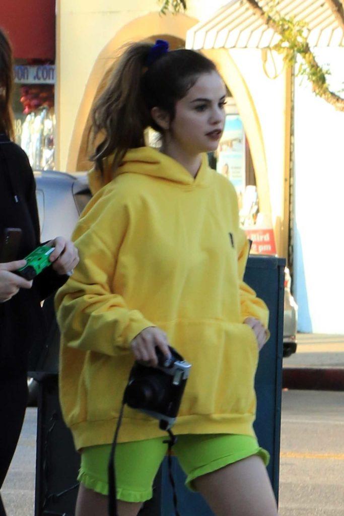 Selena Gomez in a Yellow Hoody