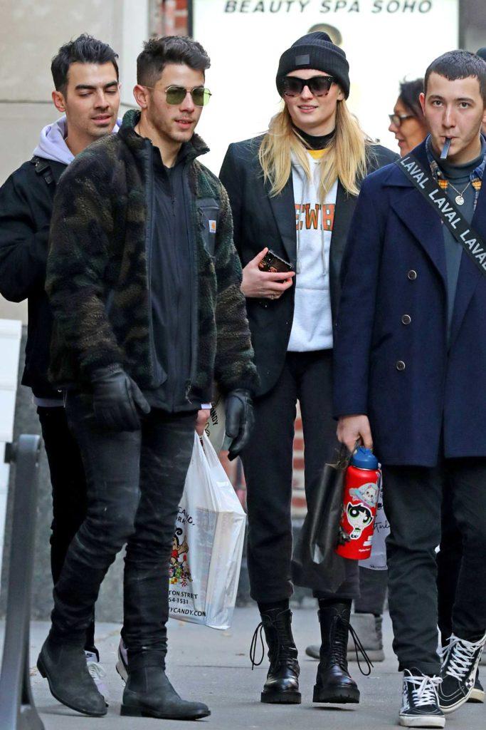 Sophie Turner in a Black Knit Hat