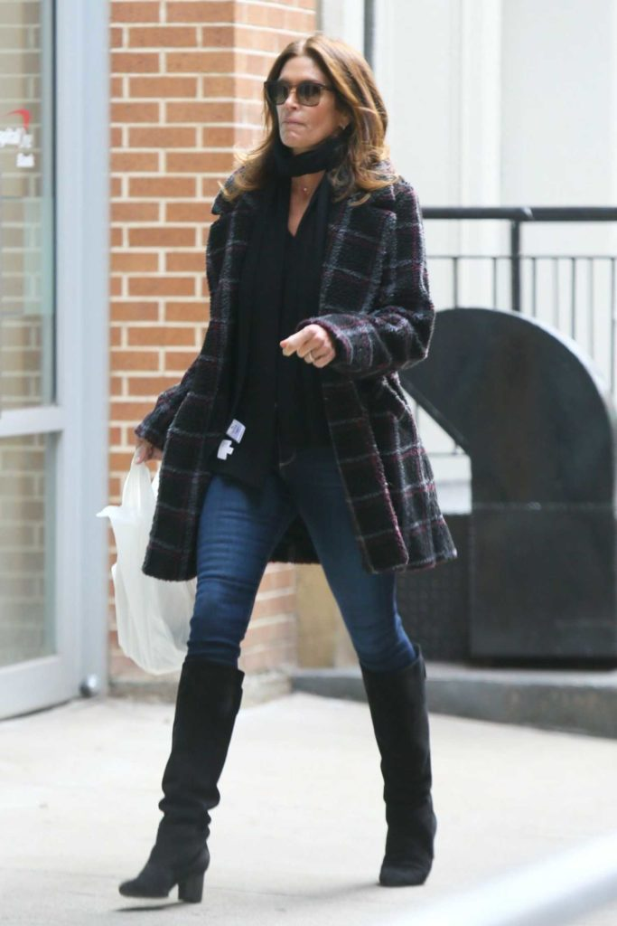 Cindy Crawford in a Black Boots