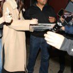 Dakota Johnson in a Beige Coat Greets Fans in West Hollywood
