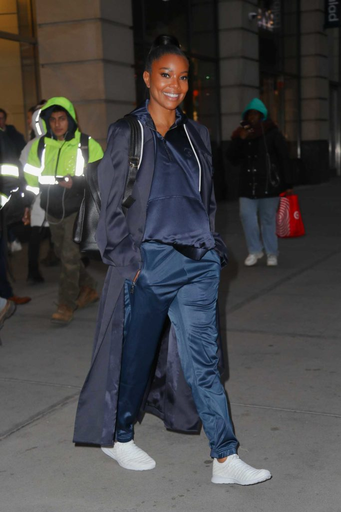 Gabrielle Union in a Black Trench Coat