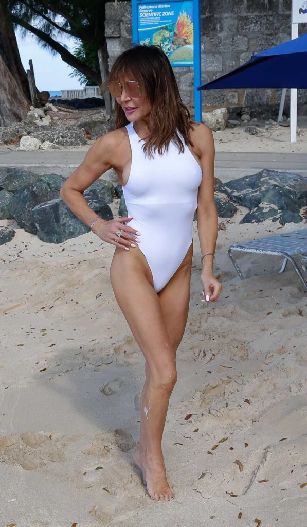 Lizzie Cundy in a White Swimsuit on the Beach in Barbados ...