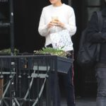 Mila Kunis in a White Sweater Leaves Alfred's Coffee in West Hollywood