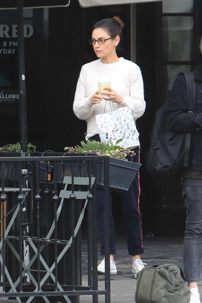 Mila Kunis in a White Sweater