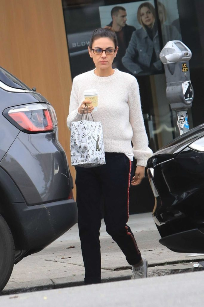 Mila Kunis in a White Sweater