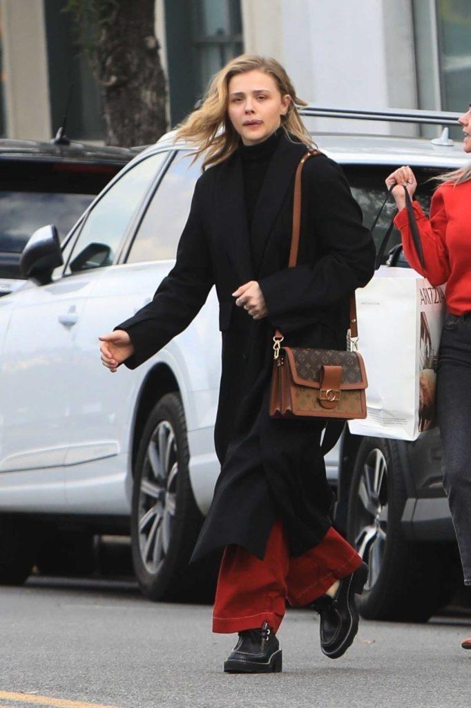Chloe Moretz in a Black Coat