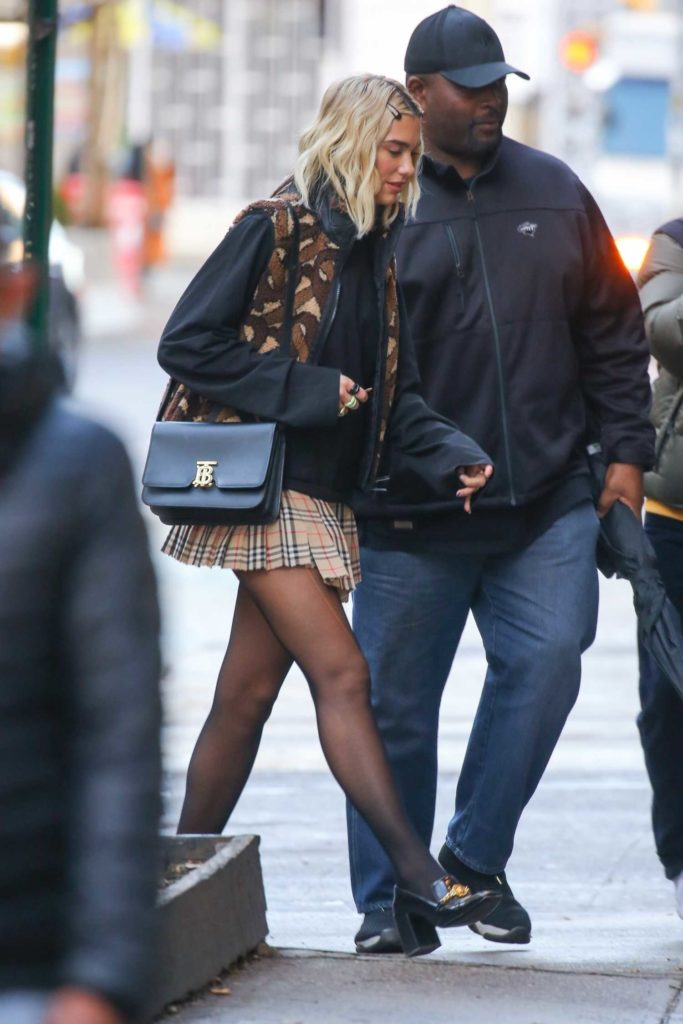Dua Lipa in a Plaid Mini Skirt
