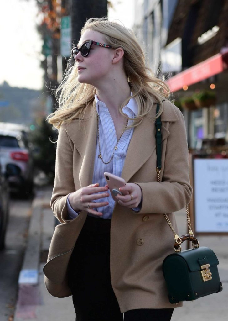 Elle Fanning in a Beige Coat