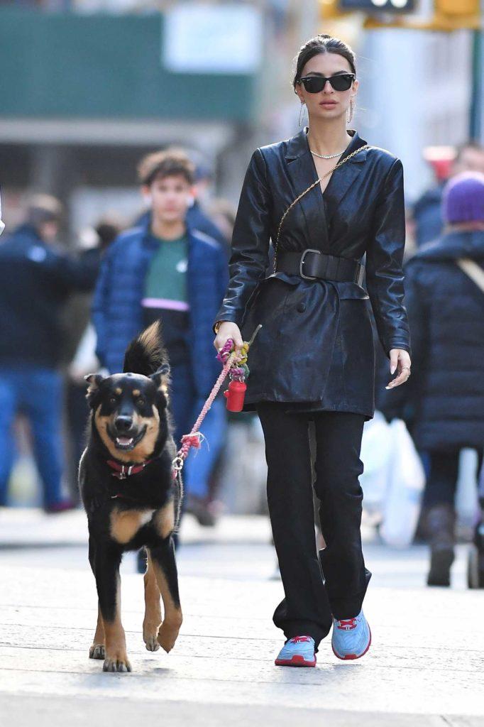 Emily Ratajkowski in a Black Leather Trench Coat