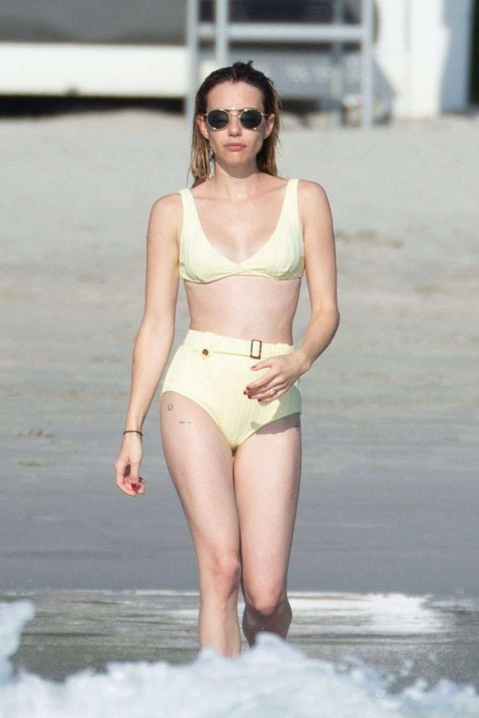 Emma Roberts in a Yellow Bikini