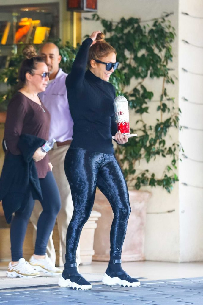 Jennifer Lopez in a Blue Satin Gym Pants
