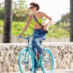 Kaia Gerber in a Neon Green Bikini Top Does a Bike Ride in Miami