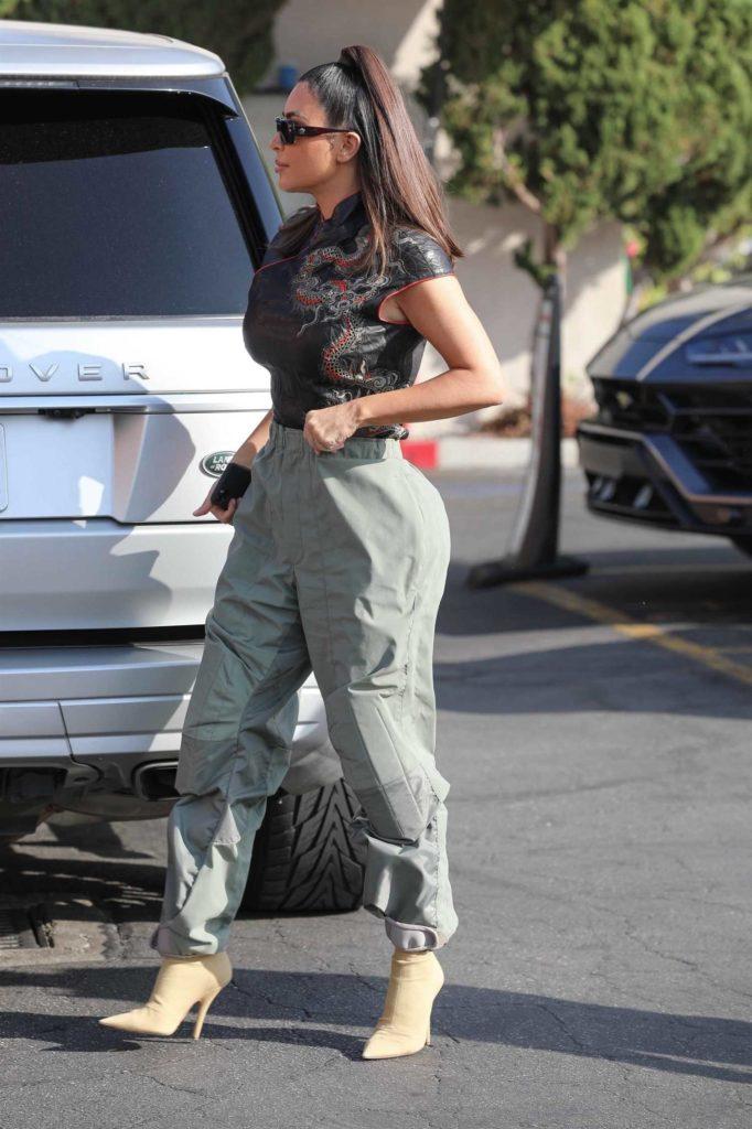 Kim Kardashian in a Gray Pants