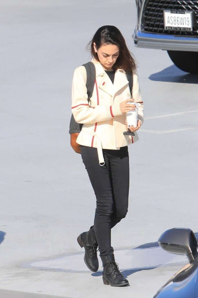 Mila Kunis in a Black Boots