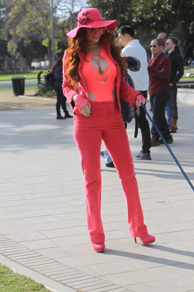 Phoebe Price in a Pink Suit