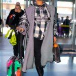 Rihanna in a Plaid Coat Arrives at JFK Airport in NY