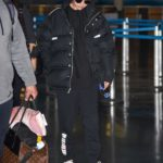 Selena Gomez in a Black Puffer Jacket Arrives at JFK Airport in New York