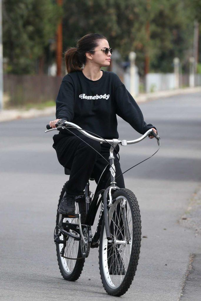 Selena Gomez in a Black Sweatsuit