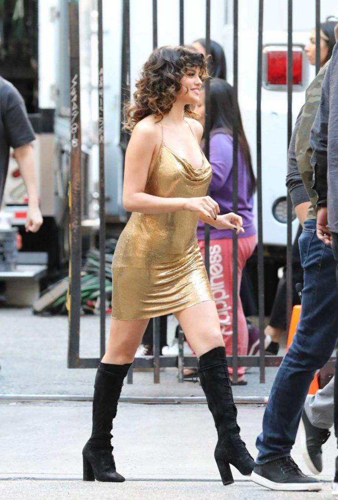 Selena Gomez in a Gold Dress