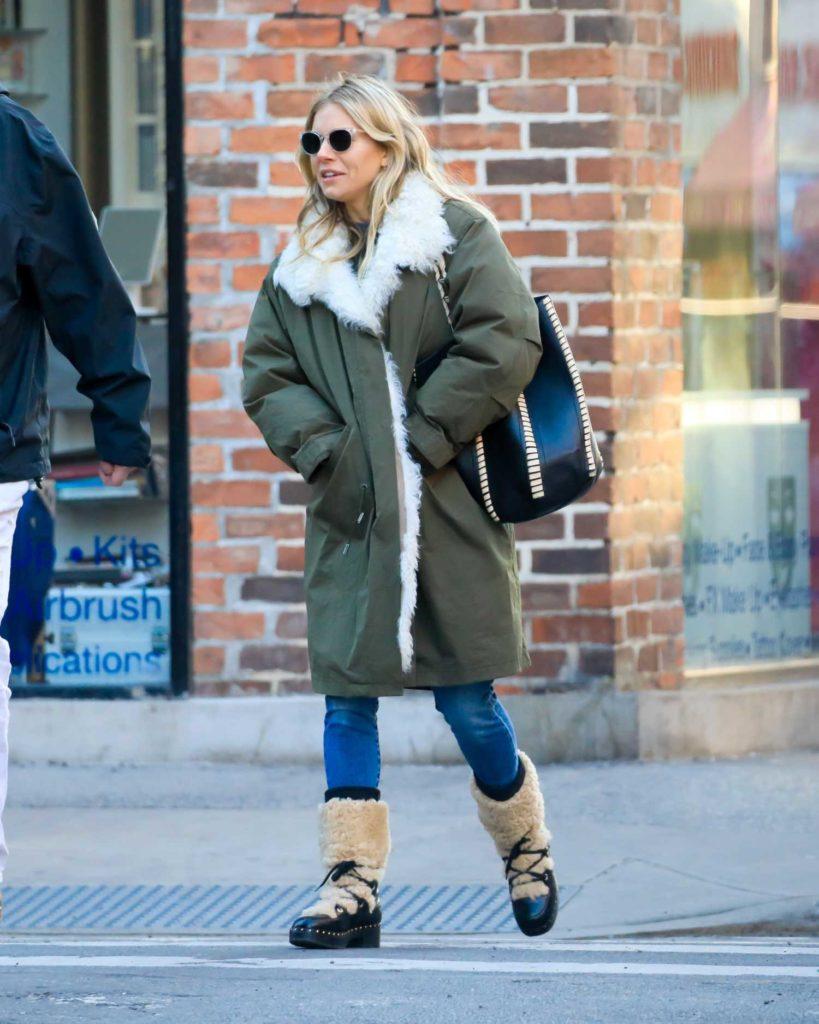 Sienna Miller in a Green Puffer Coat