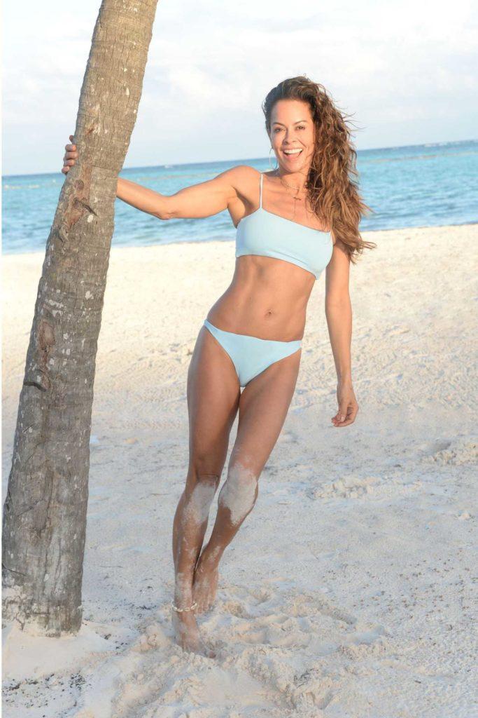 Brooke Burke in a Blue Bikini