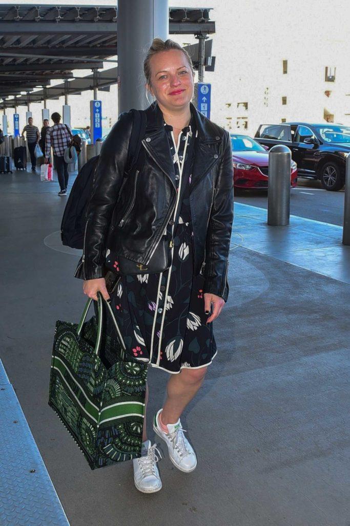 Elisabeth Moss in a Black Leather Jacket
