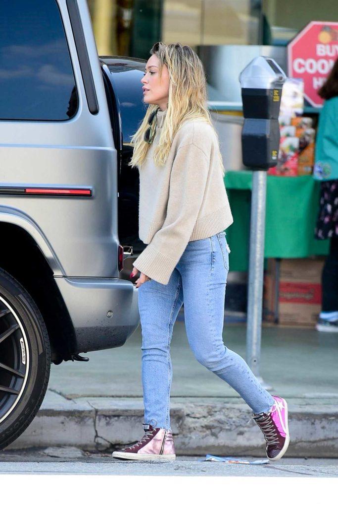 Hilary Duff in a Beige Sweater