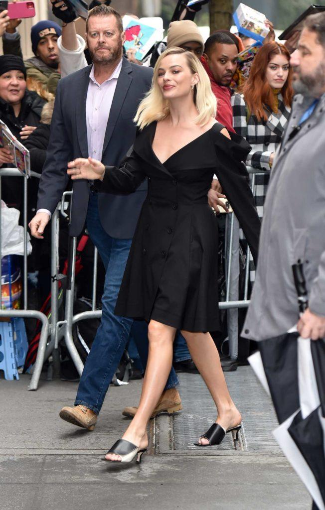 Margot Robbie in a Black Dress