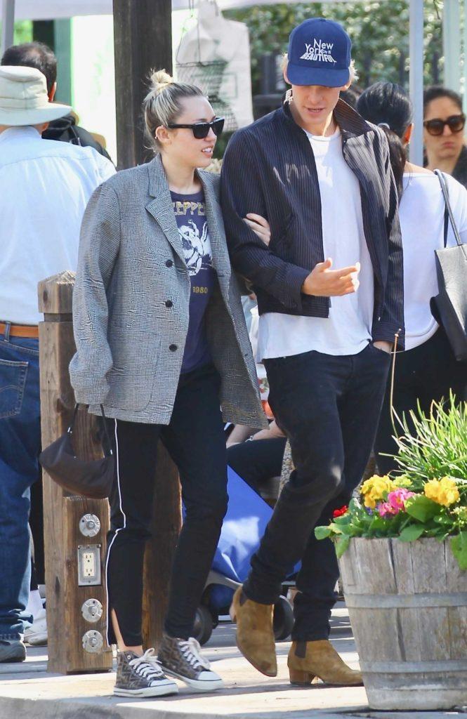 Miley Cyrus in a Gray Blazer