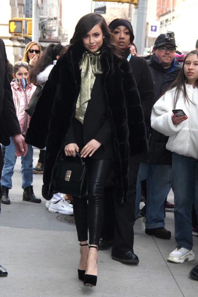 Sofia Carson in a Black Fur Coat