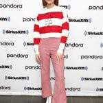 Zoey Deutch in a Red Pants Visits SiriusXM Studios in New York
