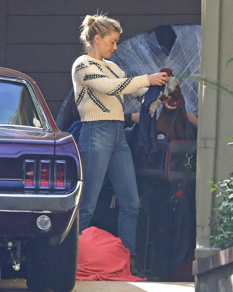 Amber Heard in a Beige Sweater