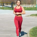 Bianca Gascoigne in a Red Workout Clothes Enjoys a Morning Jog in Kent