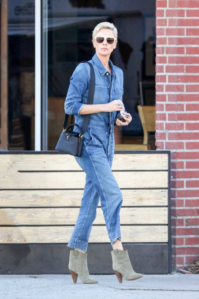 Charlize Theron in a Denim Jumpsuit