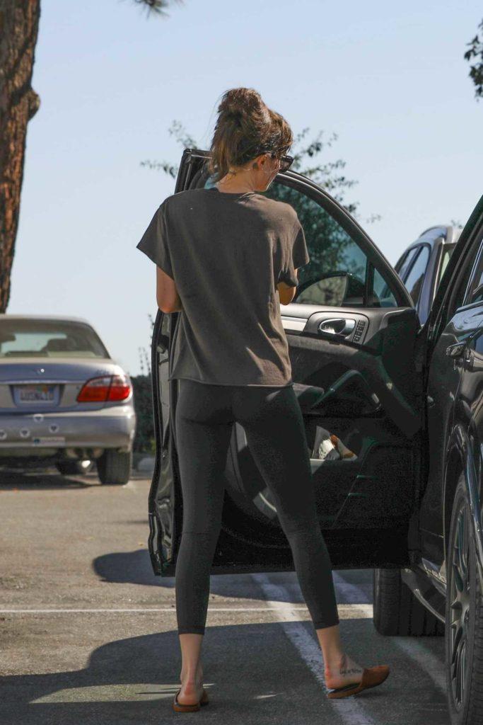 Dakota Johnson in a Black Leggings