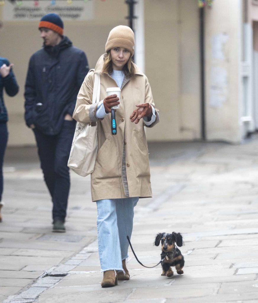 Emilia Clarke in a Beige Knit Hat