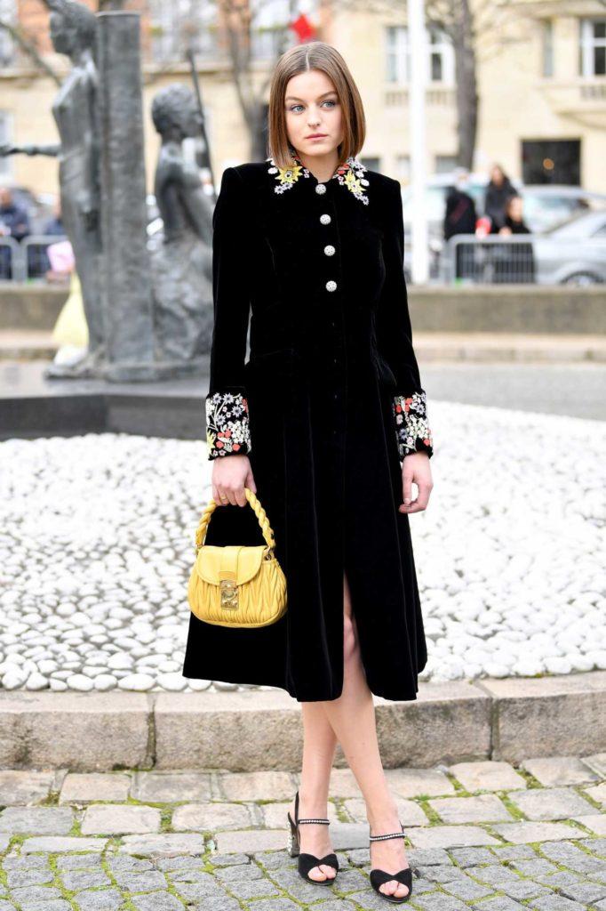 Emma Corrin in a Black Dress
