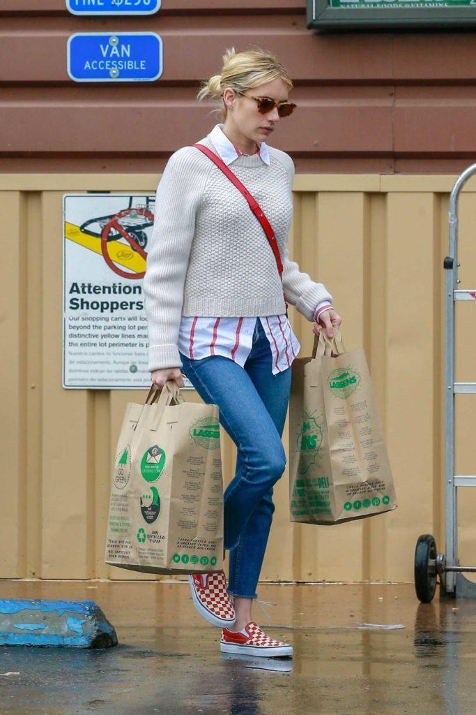 Emma Roberts in a Beige Sweater