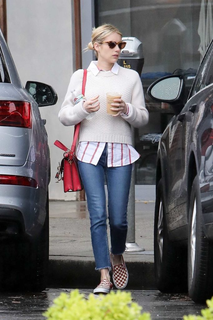 Emma Roberts in a Beige Sweater
