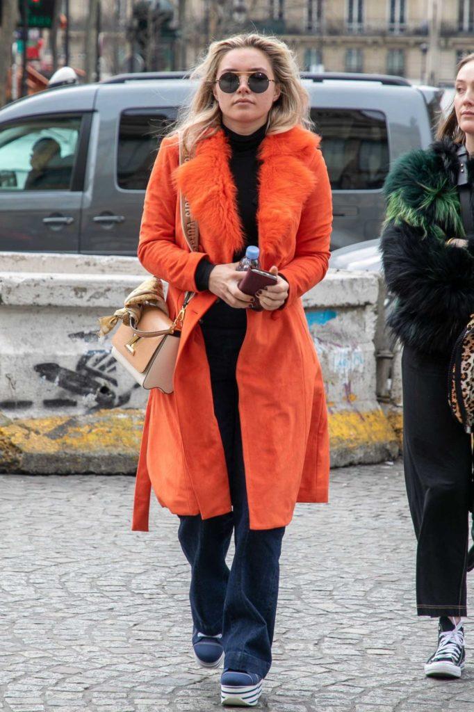 Florence Pugh in an Orange Coat